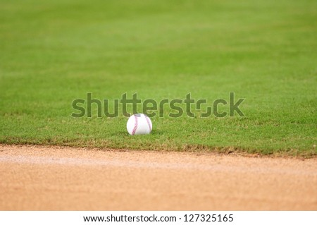 baseball lying on grass in field