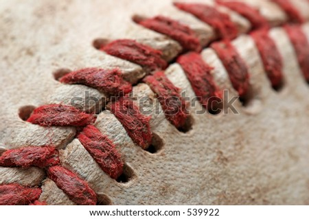 baseball macro abstract with shallow depth of field and focus near the bottom left corner - stock photo