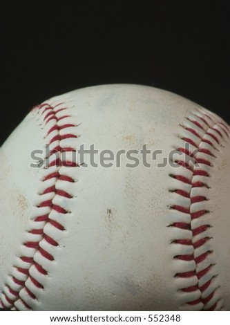 Baseball Macro with black background space available.