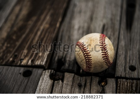 Baseball on rustic wooden background