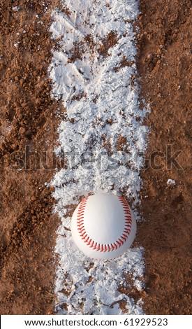 Baseball on the infield baseline - stock photo