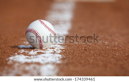 Baseball on the Infield Chalk Line - stock photo