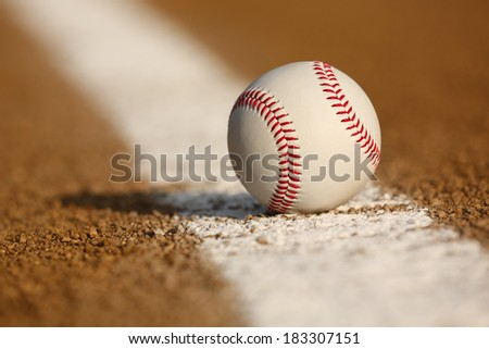Baseball on the Infield Chalk Line with room for copy - stock photo