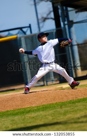 Baseball pitcher in white jersey - stock photo
