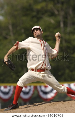 Baseball pitcher on mound about to pitch a baseball. Vertically framed shot. - stock photo