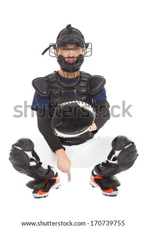 baseball player , catcher showing one secret  signal gesture - stock photo