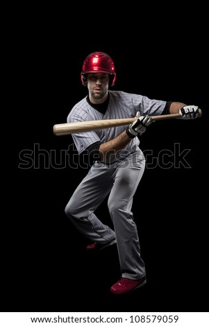 Baseball Player catching a ball on a black background. - stock photo