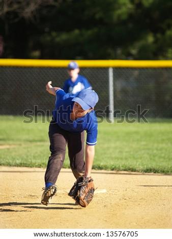 Baseball player catching a ground ball - stock photo