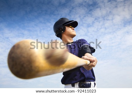 baseball player hitting - stock photo