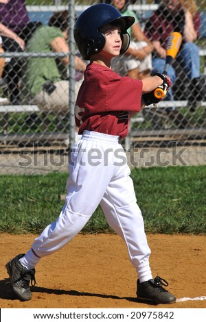 Baseball player hitting ball - stock photo