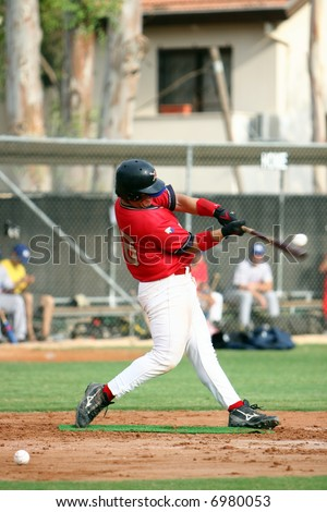 Baseball Player making contact with the ball - stock photo