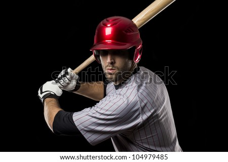 Baseball Player on a black background - stock photo