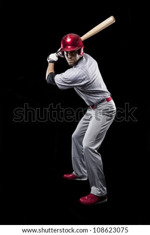 Baseball Player on a black background. - stock photo