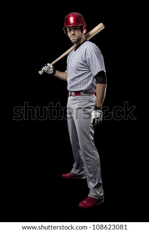 Baseball Player on a black background. - stock photo