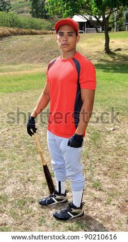 Baseball player poses with his bat - stock photo