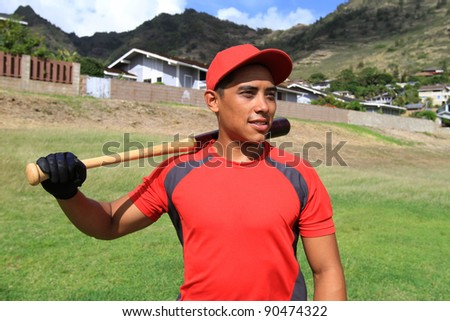 Baseball player smiles and looks into the distance - stock photo