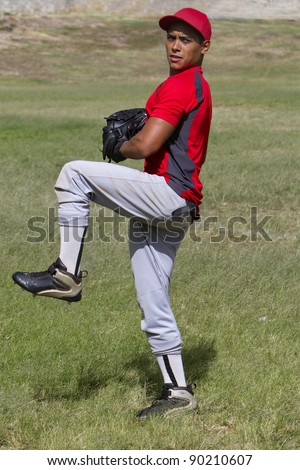 Baseball player stands ready to pitch - stock photo