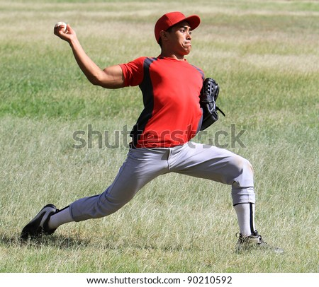Baseball player throws a ball with strength - stock photo