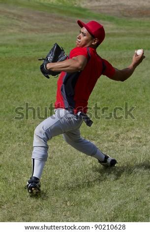 Baseball player throws the ball - stock photo