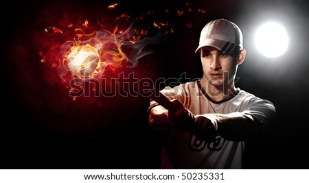 Baseball player with a bat in stadium - stock photo