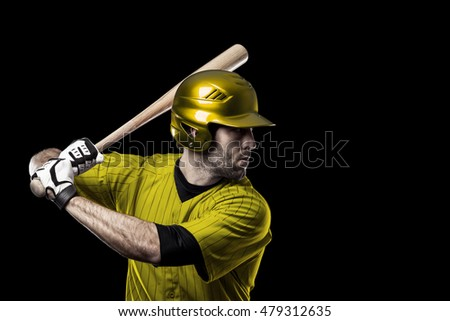Baseball Player with a yellow uniform on a black background.