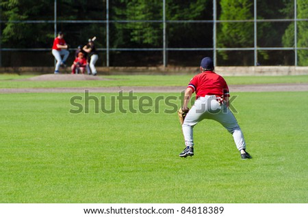 Baseball players playing the sport they love at a small stadium of the minor leagues - stock photo