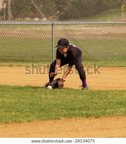 Baseball playing going for a ground ball - stock photo