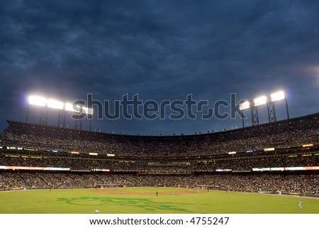 Baseball stadium at dusk - stock photo