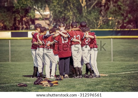 Baseball team in a huddle before a game.  Instagram toned image. - stock photo