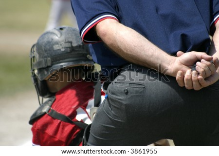 Baseball umpire and catcher - stock photo