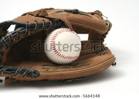Baseball with red stitching and outfielders glove (mitt) on a white background