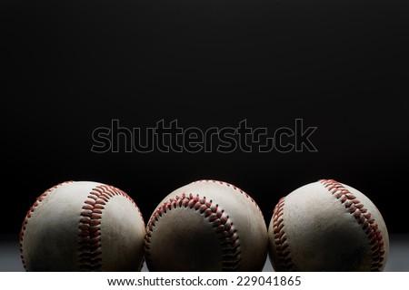 Baseballs in a row - stock photo