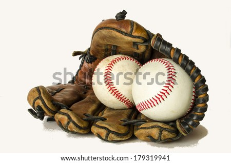 baseballs seams forming heart in glove on white