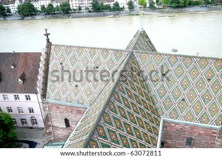 Basel Cathedral Multicolored Roof and River - stock photo
