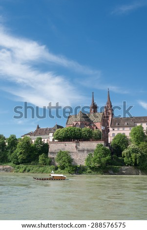 Basel cityscape with Basel Cathedral and crossing ferry.  - stock photo