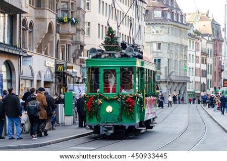 BASEL, SWITZERLAND - DECEMBER 20, 2015: Christmas Tram driven by Santa Claus in Basel , Switzerland