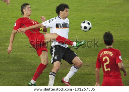BASEL, SWITZERLAND - JUNE 19:  Cristiano Ronaldo of Portugal (l) and Michael Ballack of Germany fight for the ball during a Euro 2008 match June 19, 2008 in Basel, Switzerland.  Editorial use only. - stock photo