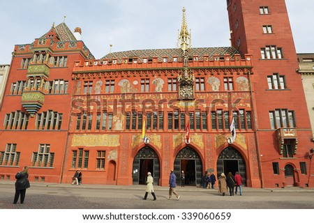 BASEL, SWITZERLAND - MARCH 01, 2009: Unidentified people walk in front of the Town Hall buylding in Basel, Switzerland.