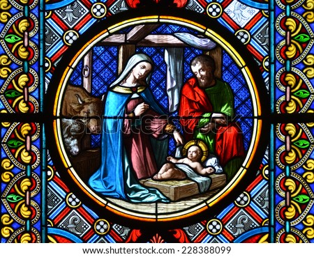 BASEL, SWITZERLAND - November 3, 2014: Nativity Scene. Stained glass window in the Cathedral of Basel, Switzerland  - stock photo