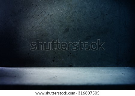 Basement like concrete wall and floor in dark bluish light.  - stock photo