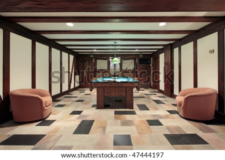 Basement pool room with wood beam ceilings