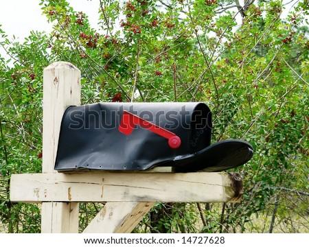 bashed up mailbox - stock photo
