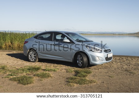 Bashkortostan, Russia - August 3, 2015: The car is a Hyundai Accent on the lake.