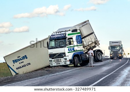 BASHKORTOSTAN, RUSSIA - JULY 12, 2015: Semi-trailer truck Volvo FH12 crashed at the interurban freeway. - stock photo