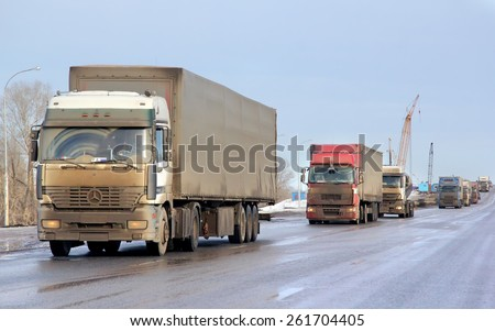 BASHKORTOSTAN, RUSSIA - MARCH 11, 2015: Very dirty semi-trailer truck Mercedes-Benz Actros at the interurban road. - stock photo