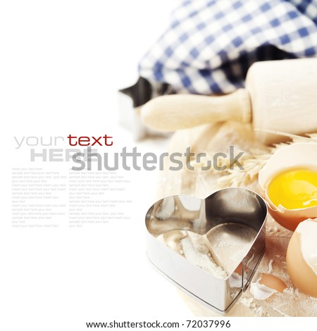 Basic baking ingredients over white (with sample text) - stock photo