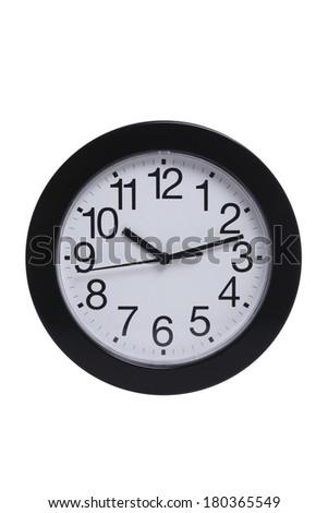 Basic black and white clock on white background - stock photo