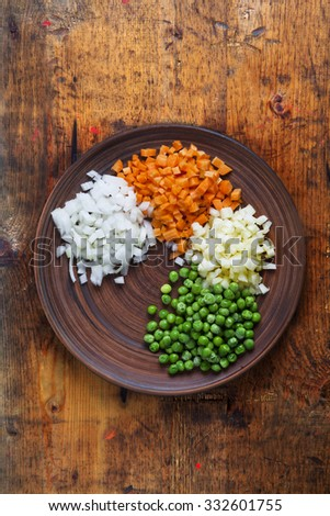 Basic Chopped Vegetables : Carrot,Celery,Onion ,Green Peas. On wooden table  - stock photo