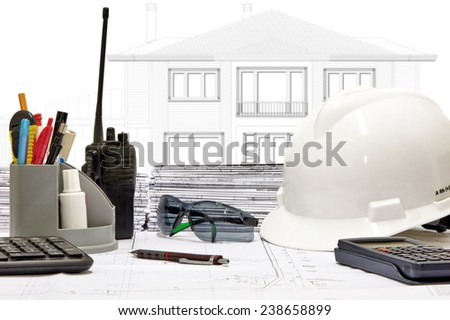 Basic instruments of a construction engineer on worktable - stock photo