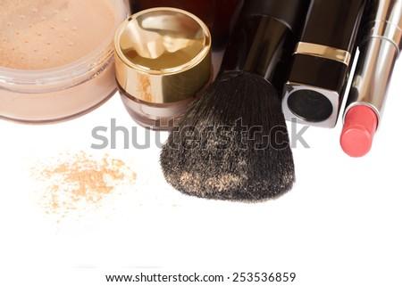 Basic make-up products with brusheÃ?? and lipstick border isolated on white background - stock photo